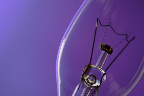 light-bulb-on-purple-background