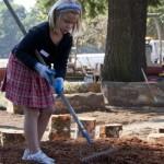 girl-raking-290x300